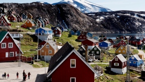This July 11, 2015 file photo shows a general view of the town of Upernavik in western Greenland. Aiming to put his mark on the world map, President Donald Trump has talked to aides and allies about buying Greenland for the U.S. A Trump ally told The Associated Press on Thursday, Aug. 15, 2019 that the president had discussed the purchase but was not serious about it. And a Republican congressional aide said Trump brought up the notion of purchasing Greenland in conversations with lawmakers enough times to make them wonder, but they have not taken his comments seriously. (Linda Kastrup/Ritzau Scanpix via AP)