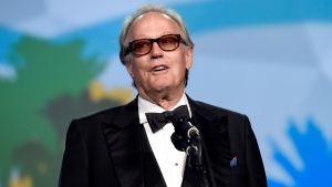In this Tuesday, Jan. 2, 2018 file photo, Peter Fonda presents the Desert Palm achievement award at the 29th annual Palm Springs International Film Festival, in Palm Springs, Calif.  (Photo by Chris Pizzello/Invision/AP, File)