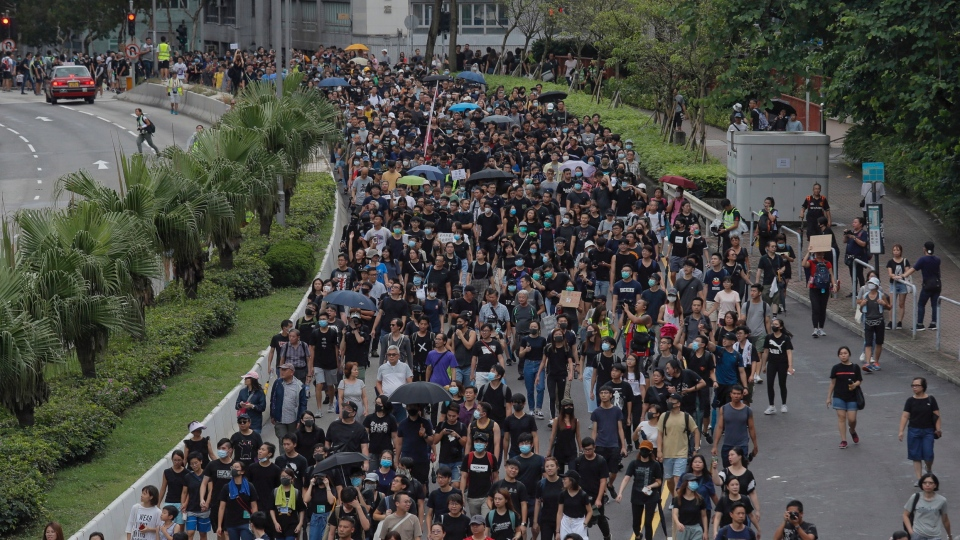 Pro-democracy protesters march in a Hong Kong street Saturday, Aug. 17, 2019. Another weekend of protests is underway in Hong Kong as Mainland Chinese police are holding drills in nearby Shenzhen, prompting speculation they could be sent in to suppress the protests. (AP Photo/Kin Cheung)