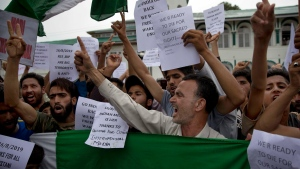 Kashmiri Muslims hold placards and shout pro-freedom slogans during a demonstration after Friday prayers amid curfew like restrictions in Srinagar, India, Friday, Aug. 16, 2019. Hundreds of people have held a street protest in Indian-controlled Kashmir as India's government assured the Supreme Court that the situation in the disputed region is being reviewed daily and unprecedented security restrictions will be removed over the next few days. (AP Photo/Dar Yasin)