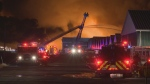 Firefighters are shown battling a blaze at a greenhouse complex in St. Catharines.