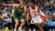Canada's Oshae Brissett, right, drives past Joe Ingles, of Australia, during an exhibition basketball game in Perth, Australia, Friday, Aug. 16, 2019. (Richard Wainwright/AAP Image via AP)