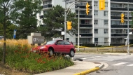 A vehicle that struck two pedestrians near CF Fairview Mall on Saturday afternoon is shown. (Tom Podolec)