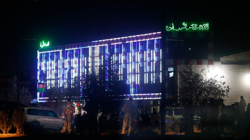 An explosion ripped through the wedding hall on a busy Saturday night in Afghanistan's capital and dozens of people were killed or wounded, a government official said. Hundreds of people were believed to be inside. (AP Photo/Rafiq Maqbool)