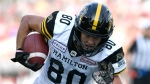 Hamilton Tiger-Cats' Caleb Holley (80) makes a touchdown against the Ottawa Redblacks during second half CFL football action in Ottawa on Saturday, Aug. 17, 2019. THE CANADIAN PRESS/Justin Tang