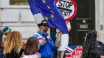 Anti-Brexit protesters demonstrate outside the Cabinet Office in Whitehall in London on Thursday, Aug. 15, 2019. (AP Photo/ Vudi Xhymshiti)