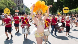 A dancer entertains the crowd during the annual gay pride parade in Montreal, Sunday, August 16, 2015. THE CANADIAN PRESS/Graham Hughes