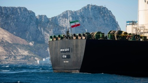 Renamed Adrian Aryra 1 super tanker hosting an Iranian flag sails in the waters in the British territory of Gibraltar, Sunday, Aug. 18, 2019. (AP Photo/Marcos Moreno)