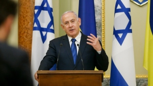Israeli Prime Minister Benjamin Netanyahu gestures while speaking during his and Ukrainian President Volodymyr Zelenskiy, joint news conference following their talks in Kyiv, Ukraine, Monday, Aug 19, 2019. (AP Photo/Efrem Lukatsky)