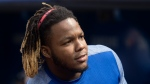Toronto Blue Jays Vladimir Guerrero Jr. watches the game from the bench in the seventh inning of their American League MLB baseball game against the Seattle Mariners in Toronto Sunday August 18, 2019. THE CANADIAN PRESS/Fred Thornhill