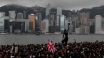 In this Sunday, July 7, 2019, photo, thousands of protesters carrying the British flag march near the harbor of Hong Kong. Hong Kong police on Tuesday confirmed it had received a report on Aug. 9, 2019, about a British foreign ministry employee who has been missing since crossing into China on a business trip. Local media reports have identified the missing man as Simon Cheng Man-kit, a trade and investment officer at the Scottish Development International section of the consulate. (AP Photo/Kin Cheung)