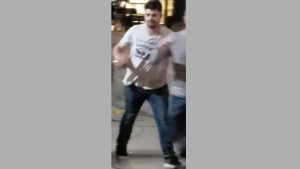 A suspected wanted in connection with an assault in the King Street and Bathurst Street area is pictured. (Handout /Toronto police)