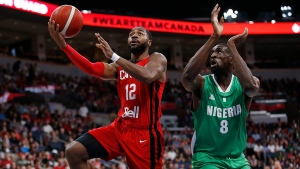 Canada's Aaron Best (12) get clear and takes the shot against Nigeria's Ekpe Udoh (8) during the first half of their exhibition game in Winnipeg, Friday, August 9, 2019. THE CANADIAN PRESS/John Woods