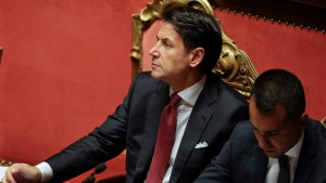 "Italian Premier Giuseppe Conte, left, sits beside Deputy-Premier Luigi Di Maio at the Senate in Rome, Tuesday, Aug. 20, 2019. Conte blasted the League's leader and Interior Minister Matteo Salvini for his decision to spark a government crisis that risk triggering ""a spiral of political and financial instability."" Conte addressed the Senate on Tuesday in a much-awaited speech after Salvini's far-right League two weeks ago landed a no-confidence vote against Conte's government pushing it on the verge of collapse. (AP Photo/Gregorio Borgia)"