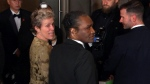 FILE - This March 4, 2018 file image taken from video shows Oscar winner Frances McDormand, foreground left, walking into the Governors Ball next to Terry Bryant, center, the man accused of stealing her Academy Award in Los Angeles. (AP Photo/Jeff Turner, file)