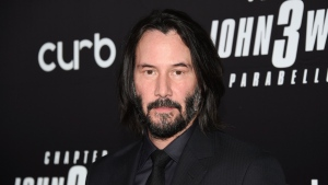 "FILE - In this May 9, 2019 file photo, actor Keanu Reeves attends the world premiere of ""John Wick: Chapter 3 - Parabellum"" at One Hanson in New York. Reeves and Lana Wachowski are returning to the world of ""The Matrix."" (Photo by Evan Agostini/Invision/AP, File)"
