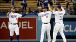 Los Angeles Dodgers' Matt Beaty (45), A.J. Pollock (11) and Joc Pederson (31) celebrate after a 16-3 win over the Toronto Blue Jays during a baseball game Tuesday, Aug. 20, 2019, in Los Angeles. (AP Photo/Marcio Jose Sanchez)