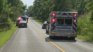 Police are shown at the scene of a homicide investigation on 2 Side Road in Burlington. (David Ritchie)