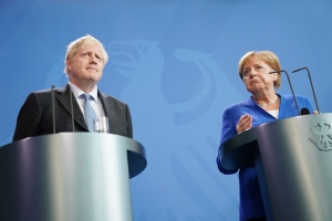"Germany's Chancellor Angela Merkel and British Prime Minister Boris Johnson attend a joint press conference, in Berlin, Wednesday, Aug. 21, 2019. German Chancellor Angela Merkel says she plans to discuss with UK Prime Minister Boris Johnson how Britain's exit from the European Union can be ""as frictionless as possible."" (Kay Nietfeld/dpa via AP)"