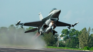 In this Sept. 16, 2014, file photo, a Taiwan Air Force F-16 fighter jet takes off from a closed section of highway during the annual Han Kuang military exercises in Chiayi, central Taiwan. (AP Photo/Wally Santana, File)