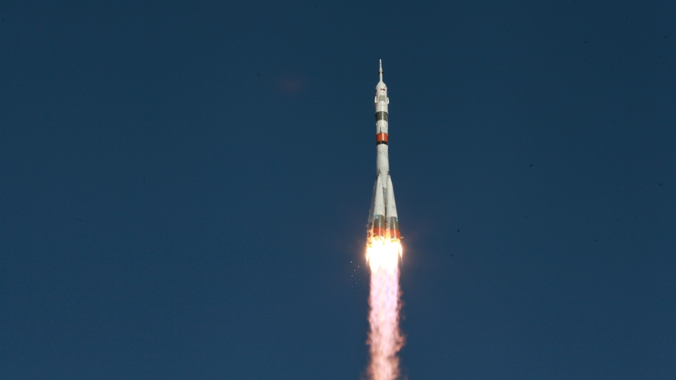 In this photo taken on Thursday, Aug. 22, 2019, and distributed by Roscosmos Space Agency Press Service, a Soyuz capsule is launched by a new Soyuz 2.1a rocket from the launch pad at Russia's space facility in Baikonur, Kazakhstan. The new Russian rocket, that is expected to replace the current model sending manned missions into space, blasted off from Kazakhstan on Thursday, carrying a Soyuz capsule with a humanoid robot that will be tested in spaceflight conditions aboard the International Space Station (ISS). (Roscosmos Space Agency Press Service photo via AP)