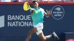 Felix Auger-Aliassime, of Canada, returns to Karen Khachanov, of Russia, during round of sixteen play at the Rogers Cup tennis tournament in Montreal, Thursday, Aug. 8, 2019. Auger-Aliassime will take on fellow Canadian Denis Shapovalov in the first round of the U.S. Open for the second year in a row. THE CANADIAN PRESS/Paul Chiasson