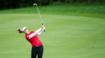 Canadian Brooke Henderson hits her approach shot on the 16th hole during second round of the CP Women's Open in Aurora, Ont., on Friday, Aug. 23, 2019. THE CANADIAN PRESS/Nathan Denette