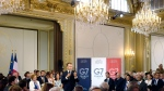 French President Emmanuel Macron delivers a speech on environment and social equality to business leaders on the eve of the G7 summit, Friday, Aug. 23, 2019 in Paris. France hosts the summit of seven advanced economies starting Saturday in the southwestern seaside resort of Biarritz, known for its surfers, casino on the beach, luxury houses from the 19th century. (AP Photo/Michel Spingler, Pool)