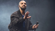 FILE - In this Oct. 8, 2016 file photo, Drake performs onstage in Toronto. The Obama summer playlist has everyone from Drake and Beyonce to Steely Dan and Frank Sinatra. Barack Obama tweeted 44 songs Saturday, Aug. 24, 2019, that he and his wife, Michelle, have been listening to. (Photo by Arthur Mola/Invision/AP, File)