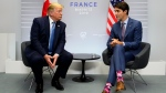 Prime Minister Justin Trudeau takes part in a bilateral meeting with U.S. President Donald Trump during the G7 Summit in Biarritz, France on Sunday, Aug 25, 2019. THE CANADIAN PRESS/Sean Kilpatrick