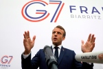 France's President Emmanuel Macron gestures as he speaks to the press after a plenary session at the Bellevue centre in Biarritz, southwestern France, Sunday Aug. 25, 2019. (Ludovic Marin, Pool via AP)