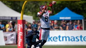 Montreal Alouettes DeVier Posey makes a catch as Toronto Argonauts Jermaine Gabriel defends in second half CFL action in Moncton, N.B. on Sunday, Aug. 25, 2019. Montreal won 28-22. THE CANADIAN PRESS/Andrew Vaughan