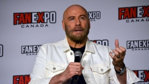 Actor John Travolta speaks to a crowd at Fan Expo Canada in downtown Toronto Sunday August 25, 2019. (Joshua Freeman /CP24)