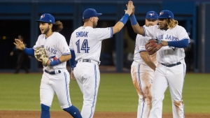 Toronto Blue Jays celebrate defeating the Atlanta Braves in Interleague MLB baseball game action in Toronto Tuesday August 27, 2019. THE CANADIAN PRESS/Fred Thornhill