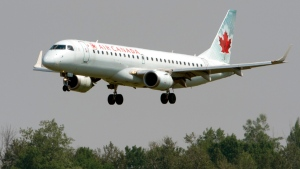 An Air Canada flight makes its final approach as it lands in Ottawa on July 3, 2019. (THE CANADIAN PRESS/Adrian Wyld)