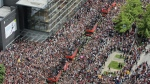 Fans cheer as the Toronto Raptors pass by during the 2019 Toronto Raptors Championship parade in Toronto, on Monday, June 17, 2019. The federal government is fining a rogue drone pilot for flying the device in downtown Toronto as crowds celebrated the Raptors' historic NBA championship win and again during the victory parade four days later. THE CANADIAN PRESS/Andrew Lahodynskyj