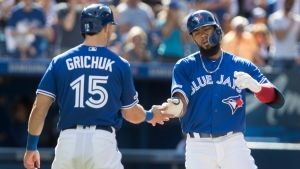 Toronto Blue Jays Teoscar Hernandez greeted at home plate by Randal Grichuk after he hit two run home run against the Houston Astros in the third inning of their American League MLB baseball game in Toronto on Saturday, August 31, 2019. THE CANADIAN PRESS/Fred Thornhill