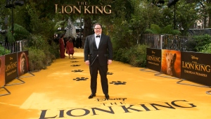In this July 14, 2019 file photo, director Jon Favreau poses for photographers upon arrival at the 'Lion King' European premiere in central London. Hollywood's summer season came to a close Sunday, Sept. 1 with a whimper. The Labor Day weekend is traditionally a quiet one for movie theaters. The Walt Disney Co. accounted for about half of all ticket sales in U.S. and Canada theaters. (Photo by Joel C Ryan/Invision/AP, File)