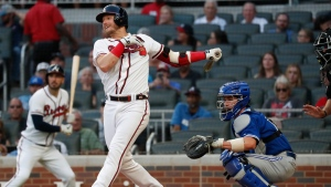 Atlanta Braves third baseman Josh Donaldson (20) drives in a run with a base hit as Toronto Blue Jays catcher Beau Taylor (72) watches during the first inning of a baseball game Tuesday, Sept. 3, 2019, in Atlanta. (AP Photo/John Bazemore)