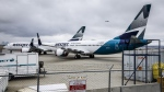 WestJet Airlines Ltd. says it is removing its grounded Boeing 737 Max jets from service until at least Jan. 5, affecting thousands of passengers with travel plans during the busy winter holiday season. Grounded WestJet Boeing 737 Max aircraft are shown at the airline's facilities in Calgary, Tuesday, May 7, 2019. THE CANADIAN PRESS/Jeff McIntosh