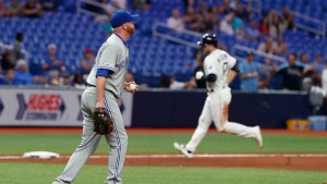 Toronto Blue Jays pitcher Buddy Bosher, left, heads back to mound after giving up a home run to the Tampa Bay Rays during the seventh inning of a baseball game Thursday, Sept. 5, 2019, in St. Petersburg, Fla. (AP Photo/Scott Audette)