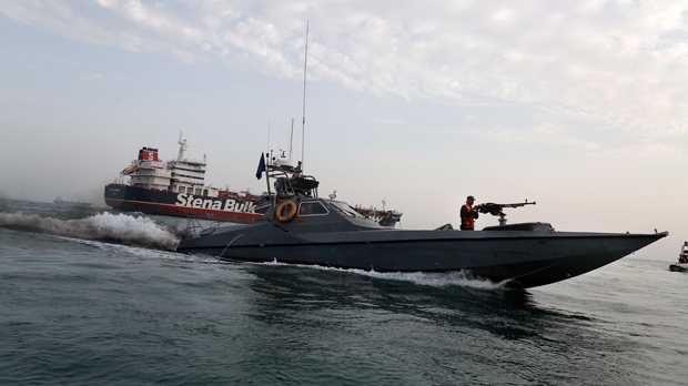 In this July 21, 2019 file photo, a speedboat of the Iran's Revolutionary Guard moves around a British-flagged oil tanker, the Stena Impero, which was seized by the Guard, in the Iranian port of Bandar Abbas. (Hasan Shirvani/Mizan News Agency via AP, File)