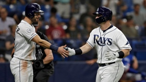 Tampa Bay Rays' Mike Zunino, right, celebrates with Kevin Kiermaier after hitting a two-run home run off Toronto Blue Jays starting pitcher Clay Buchholz during the second inning of a baseball game Friday, Sept. 6, 2019, in St. Petersburg, Fla. (AP Photo/Chris O'Meara)
