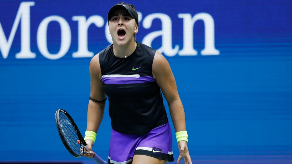 Bianca Andreescu, of Canada, reacts after scoring a point against Serena Williams, of the United States, during the women's singles final of the U.S. Open tennis championships Saturday, Sept. 7, 2019, in New York. (AP Photo/Adam Hunger)