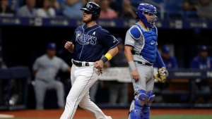 Tampa Bay Rays' Mike Brosseau, left, scores in front of Toronto Blue Jays catcher Reese McGuire on a sacrifice fly by Travis d'Arnaud during the eighth inning of a baseball game Saturday, Sept. 7, 2019, in St. Petersburg, Fla. (AP Photo/Chris O'Meara)