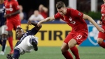 FILE - Toronto FC's Patrick Mullins (13) controls the ball against New England Revolution midfielder Luis Caicedo, left, in the first half of an MLS soccer match at Gillette Stadium, Saturday, Aug. 31, 2019, in Foxborough, Mass. (THE CANADIAN PRESS/AP/Elise Amendola)