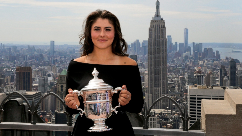 Bianca Andreescu, of Canada, poses with the US Open women's singles championship trophy at Top of the Rock, Sunday, Sept. 8, 2019, in New York. Andreescu defeated Serena Williams, of the United States, in the women's singles final of the U.S. Open tennis championships. (AP Photo/Charles Krupa)