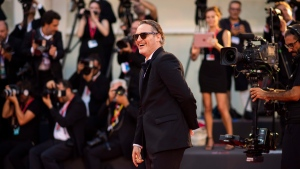 Actor Joaquin Phoenix poses for photographers upon arrival at the premiere of the film 'Joker' at the 76th edition of the Venice Film Festival, Venice, Italy, Saturday, Aug. 31, 2019. Hollywood stars Joaquin Phoenix and Meryl Streep will be the toast of the Toronto International Film Festival tonight. THE CANADIAN PRESS/Photo by Arthur Mola/Invision/AP