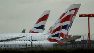 British Airways planes sit parked at Heathrow Airport in London, Monday, Sept. 9, 2019. British Airways says it has had to cancel almost all flights as a result of a pilots' 48-hour strike over pay. (AP Photo/Matt Dunham)