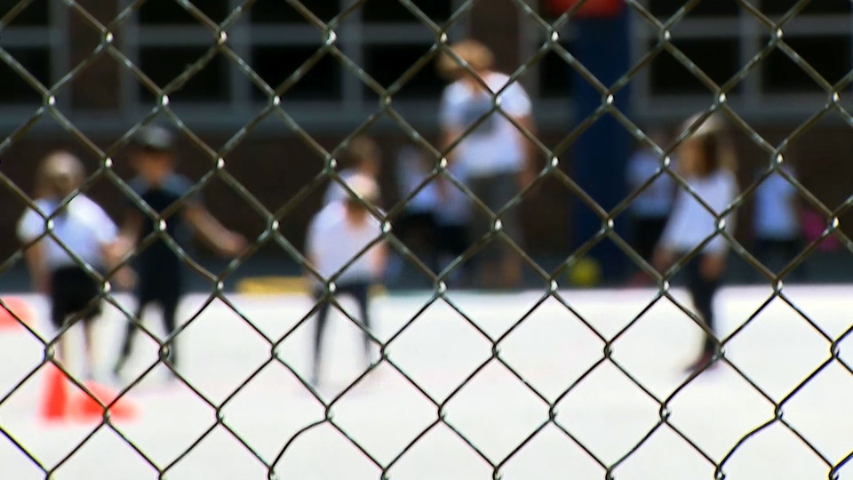 Children are seen playing in a schoolyard. (CTV News Toronto)